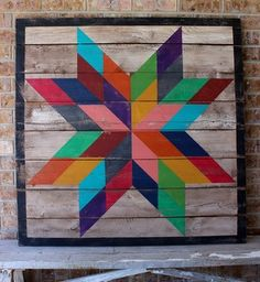 """A large colorful hand painted Texas Star barn quilt made from reclaimed wood and finished for indoor or outdoor use. Sized 44"""" x 44""""."""