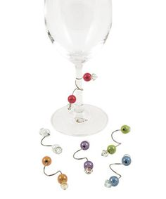 I LOVE THE IDEA OF MAKING THESE & USING THEM AS FAVOR/PLACE CARDS\ TABLE DECOR! (they're super simple to make, and coordinate w/wedding colors & themes)No more playing whose is whose at dinner parties: These colorful wine charms make it easy to identify which glass belongs to which guest.