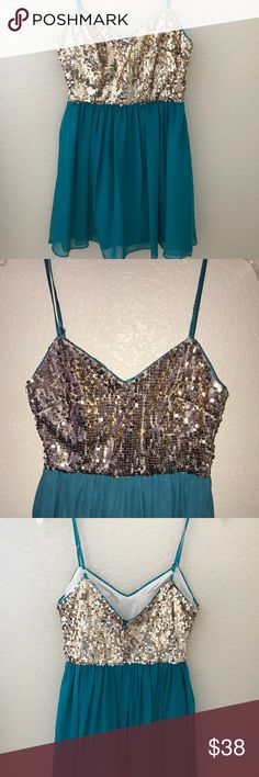 Blue and sparkly gold homecoming/prom dress Gorgeous dress for homecoming or prom. Only worn once for homecoming. Size 5/6. Has enough padding in it that you don't need to wear a bra with it. Also it's super comfy, so that's a plus! Hailey Logan Dresses Prom