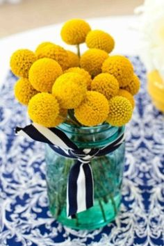 These flowers would be great in little vases running down a party table, but I'm also thinking of the idea of cake pops dipped in hundreds and thousands to match, or those licorice allsorts with the hundreds and thousands on skewers in little vases for contrast...