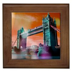 "London Tower Bridge, Bokeh Orange. London Tower Bridge, Bokeh Orange Framed Tiles. Brighten up any environment with this ceramic tile that encapsulates the design of the artist. This item also includes a wood colored frame giving it a complete finish. Printed on the tile using a heat dye sublimation technique, the image is protected from smudges and water.Dimnesions: 5.5"" x 5.5"". Tile without frame measures 4.25"" x 4.25"" x 1/6"".Dishwasher safe."
