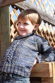 "This is a cozy little sweater with a shawl collar to keep your little guy warm while making him look like a little man. This raglan sweater is worked from the top-down. The cabling is centered in the front with an XO pattern. The shawl collar is picked up along the neck edge and requires short rows. Gauge - 20 sts. x 28 rows = 4"" in stockinette stitch."