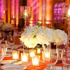 Moroccan colour theme - orange, pink & white reception decorations.