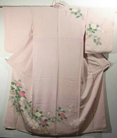 This is a charming Houmongi Kimono with a design of 'botan' (peony) and 'ume'(Japanese plum) on bamboo fence, which is dyed.