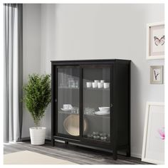 IKEA HEMNES Glass-door cabinet Black-brown 120x130 cm Sliding doors do not take up any space when opened.