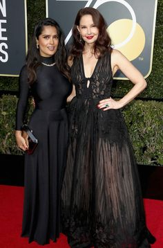 Salma Hayek in Balenciaga and Ashley Judd in Elie Saab attends the 75th Annual Golden Globe Awards in L.A. #bestdressed