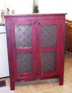 """Country Rustic Prim Furniture Handcrafted Pie Safe With Punched Tin Doors to add to your country rustic prim decor.    Comes with four punched tin pieces in two raised panel doors.     Measures 45"""" H x 33""""W x 12""""D"""