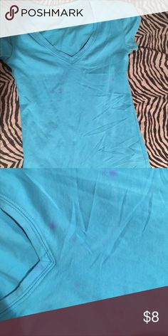 Baby blue tshirt This shirt is in good condition minus some stains on the front as shown in the picture and one little stain as well on the back but they're not really noticeable. It looks good dressed up with a scarf or dressed down. I'm selling because I don't really wear it anymore. Cheaper on Ⓜ️ercari Tops Tees - Short Sleeve