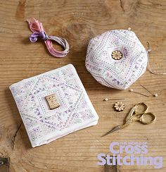 Pins & needles! Cross stitch patterns to make accessories for a stitcher - a pretty needlecase and biscornu pincushion. In The World of Cross Stitching magazine issue 203