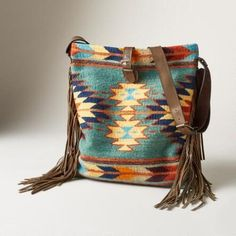 Our appealing 'Harvest Moon' fringed, wool and leather bag channels desert vistas.