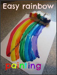 use cotton balls and clothespins to paint every color of the rainbow at once.