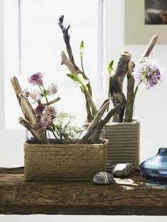 rope wrapped vases.  i love the driftwood and flowers too