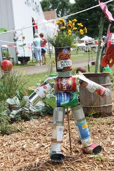 creative recycling ideas for the garden! tin can flower planter