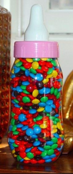 Count the Candies | 30 Baby Shower Games That Are Actually Fun  Fill a giant bottle with candies, and have guests guess how many there are. Whoever comes closest takes the treats home.