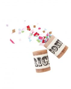 Pass out these confetti or rice canisters for a festive post-ceremony toss (from Tinsel Trading Co.)