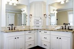 Luxury large white master bathroom cabinets with double sinks. Stock Photo - 17056378 Really like this...we should consider the bronze metal ware...like the mirror framing and counters