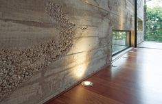I love the look of concrete incorporated in homes..on walls, floors, counters..I plan on using it as a shower with smooth river rock floor..