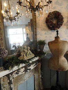 vintage chandeliers, mirror, mantel, dressform