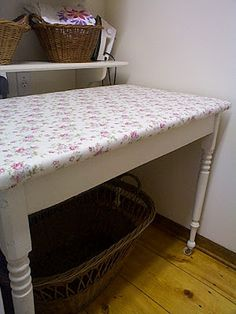 Oh I would love one of these for a laundry room.  Ironing/folding table recover.  No more ironing board...awesome!