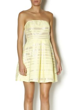 Yellow is THE color of summer! We <3 this strapless dress, with sheer horizontal stripes throughout. Perfect for a party or outdoor brunch.