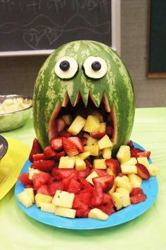 Puking Monster Melon Out of all of the creative watermelon displays I've seen, this one is my favorite for Halloween. It's actually pretty manageable, too. The only carving required is the monster mouth. Use the watermelon and other fruit to fill and let spill out of it's mouth for display.  64 Non-Candy Halloween Snack Ideas