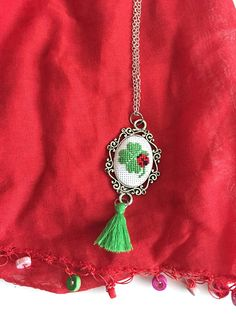 Shamrock embroidery necklace.