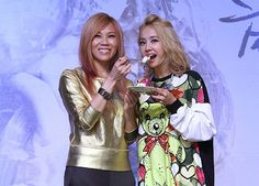 """Singaporean singer Tanya Chua held a press conference to promote her new music album """"Angel vs. Devil"""" in Taipei, Taiwan, September 23, 2013. Taiwanese singer Jolin Tsai came to the press conference to show her full support for Tanya."""