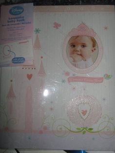 "Disney Princess Keepsake Baby's First Year Memory Book for Baby Girl ""Dreams Come True"" Disney,http://www.amazon.com/dp/B0050OEBFQ/ref=cm_sw_r_pi_dp_pBaFsb0FYHQDZ1SZ"