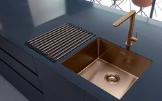 Stunning Cooper Sink with dark blue grey worktops. Creates a cool contrast effect for your kitchen. From the Caple brand at Culina & Balneo