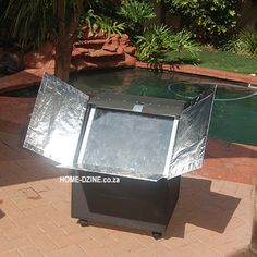 Making your own solar oven is one way to cut down on electricity usage. Even a basic solar oven can be used to defrost and perform as a slow cooker. Here are instructions for a basic solar oven that won't cost much to make. Solar Oven Diy, Diy Solar, Solar Panel System, Solar Panels, Green Life, Go Green, Under Desk Storage, Electricity Usage, Fire Pots