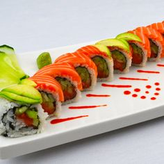 Redfish Roll: Spicy Tuna Roll topped with Sake & Avocado