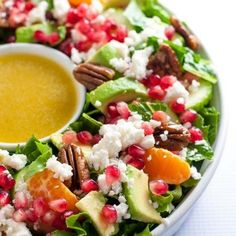 This Pomegranate Mandarin Salad with Avocado and Feta is a festive salad for any winter meal! It's bursting with fruit rich in Vitamin C, crunchy pecans and creamy avocado, and topped with crumbled feta or goat cheese. |www.flavourandsavour.com