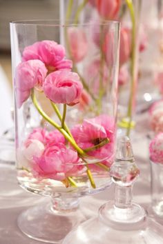 Would be nice for bridal or baby shower.Hurricane centerpieces with pink ranunculus or peonies Shower Centerpieces, Wedding Centerpieces, Wedding Decorations, Centerpiece Ideas, Centrepieces, Ranunculus Centerpiece, Ranunculus Bouquet, Floral Centerpieces, Desserts Roses