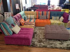 An eclectic mix but effective for fun flexible seating - really popular for family rooms.