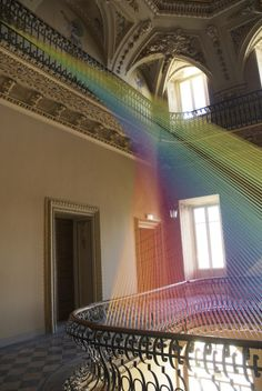 Artist Gabriel Dawe created this incredible installation in Como, Italy as part of Miniartextil, an annual exhibition of contemporary art. Dawe created Plexus no. 19, a stunning thread installation that's beautifully spread across two balconies in the atrium of a historic villa. The early 19th century neoclassic house, called Villa Olmo, was acquired in 1924 by the municipality of Como and is now open to the public only during cultural events and art exhibitions like this.