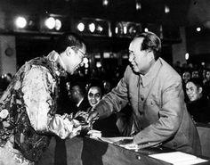 The Dalai Lama shaking Chairman Mao's hands on Oct 13, 1954
