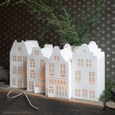 These paper canal houses are easy to make, and they look so elegant on your mantel with just a few LED lights and some fresh greenery. house How to Make Paper Canal Houses for Christmas Diy Christmas Village, Paper Christmas Decorations, Christmas Villages, Christmas Paper, Diy Christmas Gifts, Holiday Crafts, Holiday Decor, Christmas Houses, Christmas Greenery