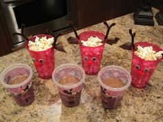 Elf on a Shelf - Antic: He put out a snack for everyone: chocolate milk & reindoor popcorn