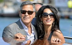 Alamuddin take a taxiboat on their arrival in Venice on the eve of their wedding.