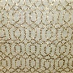 This is a tan and gold geometric design drapery fabric, suitable for any decor in the home or office.  Perfect for pillows, drapes and bedding.