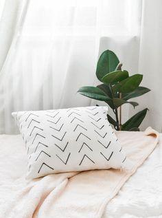 23 Modern + Rustic DIY Decor Ideas for the Cancer Zodiac via Brit + Co, Modern aztec print cushion cover, minimalist patterns