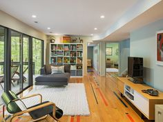 family room with reclaimed basketball court wooden for flooring of Flooring Exquisite Ideas to Try in Your Family Room