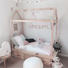 House framed bed.  seriously, what is my obsession with house bed frames?   Love the storage under this one