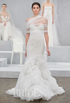 "Brides: Monique Lhuillier - Spring 2015. ""Escape"" strapless draped tulle trumpet wedding dress with a sweetheart neckline, floral skirt, and a sheer shrug, Monique Lhuillier"