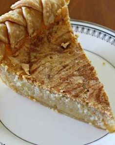 Cinnamon Swirl Buttermilk Pie melts in your mouth for a #Thanksgiving #dessert that is a twist on classic buttermilk pie. This adds swirls of #cinnamon to create a dense, custardy treat. @Carrie Fields