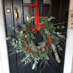 Pine and Moss Wreath with Eucalyptus, Cones, red Berries and red Ribbon. Christmas Flowers, Christmas Wreaths, Moss Wreath, Christmas Arrangements, Table Centers, Red Berries, Red Ribbon, Door Wreaths, Ladder Decor