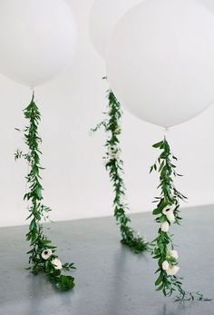 White Balloons. One per table. Instead of greenery, there would be white and green tissue paper tassels down the ribbon. #Floral