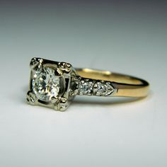 14K white and yellow gold ring.  Features one transitional diamond, G-H in color and VS2 in clarity, 0.78cttw