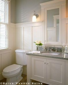 half bath downstairs - maybe tile instead of wainscotting. marble top. sink with cabinet.