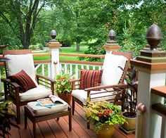 Inexpensive Impact        Several colors of wood stains make the columns, pergola roof, and deck railings stand out against the siding. Copper finials add a decorative flourish to the front deck railing.